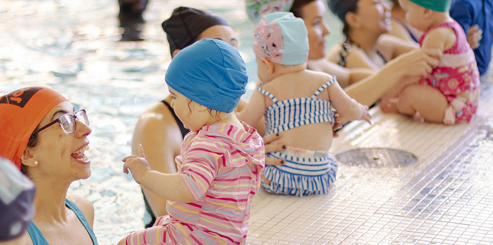 IYC Banner Image - Children and Parents at Swimming Pool